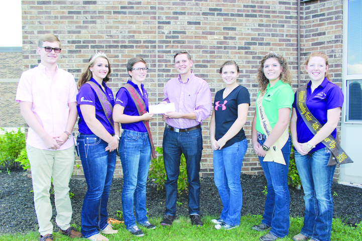 Pictured here is the presentation of the $100 check from Congressman Brad Wenstrup to the Adams County Junior Fair Board.  From left, Jace Howard (President Junior Fair Board), Caitlin Young (Fair Queen and Junior Fair Board member), Molly Bauman (Secretary, Junior Fair Board), Alex Scharfetter (Wenstrup Campaign Manager), Kelsea Hamilton (Reporter, Junior Fair Board), Madison Siders (2016 Cattlemen Ambassador and Junior Fair Board member), and Jordan Crum (Chairman of Flagpole Committee, Junior Fair Board member).