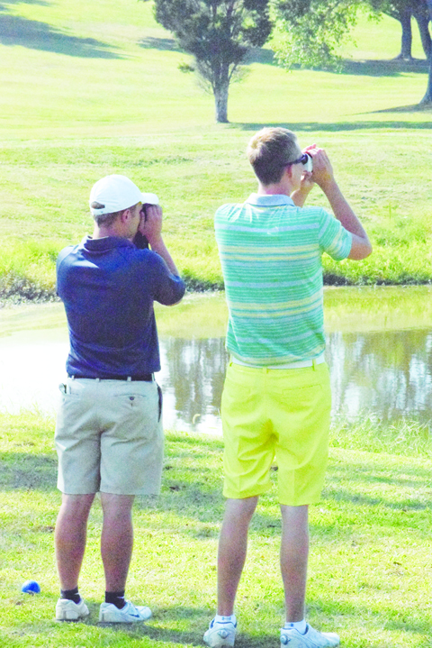 They aren't taking a break to do some bird watching on the golf course, but North Adams' Patrick England, left, and West Union's Craig Horton check out all the curves and angles before teeing off on hole 10 at Hilltop in the second round of the Boys SHAC Golf Tournament.