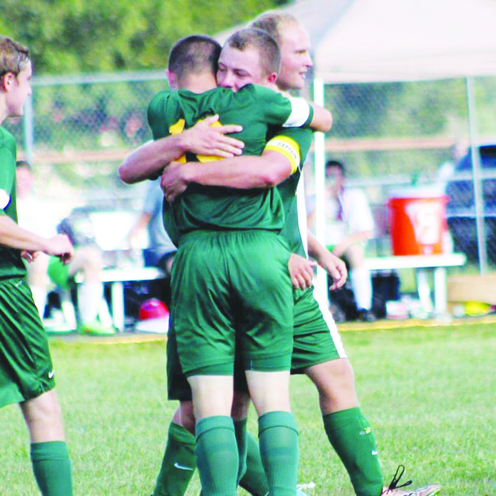 It was an emotional moment between two brothers after freshman Brandon Figgins scored his first high school goal and was embraced by his brother Ben, a senior.  Brandon's goal turned out to be a memorable one as it was the only goal in a 1-0 North Adams win over West Union. (Photo by Patrice Yezzi England)