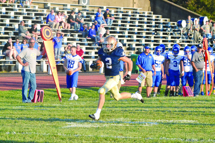 This sight haunted the Manchester Greyhounds and their faithful in last Friday night's game with Portsmouth Notre Dame as Notre Dame's Sam Kayser heads to the end zone on a first quarter punt return that gave the home team a 14-0 advantage, in an eventual 59-0 victory.