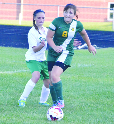 "North Adams' Allison Harper, left, decides to take a step ""on the ball"" as she tries to maneuver around West Union's Heidi Hunter (40) during girls' soccer action from Monday evening"