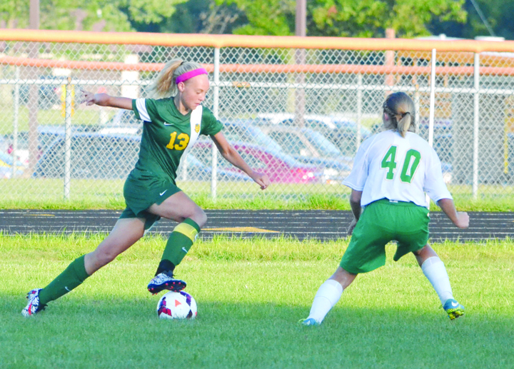 North Adams' Jessica Woodall (8) battles for possession with West Union's Anna Shupert during Monday's girls soccer action.  Woodall scored two second half goals and Shupert had the only West Union goal in a 9-1 Lady Devils' win.