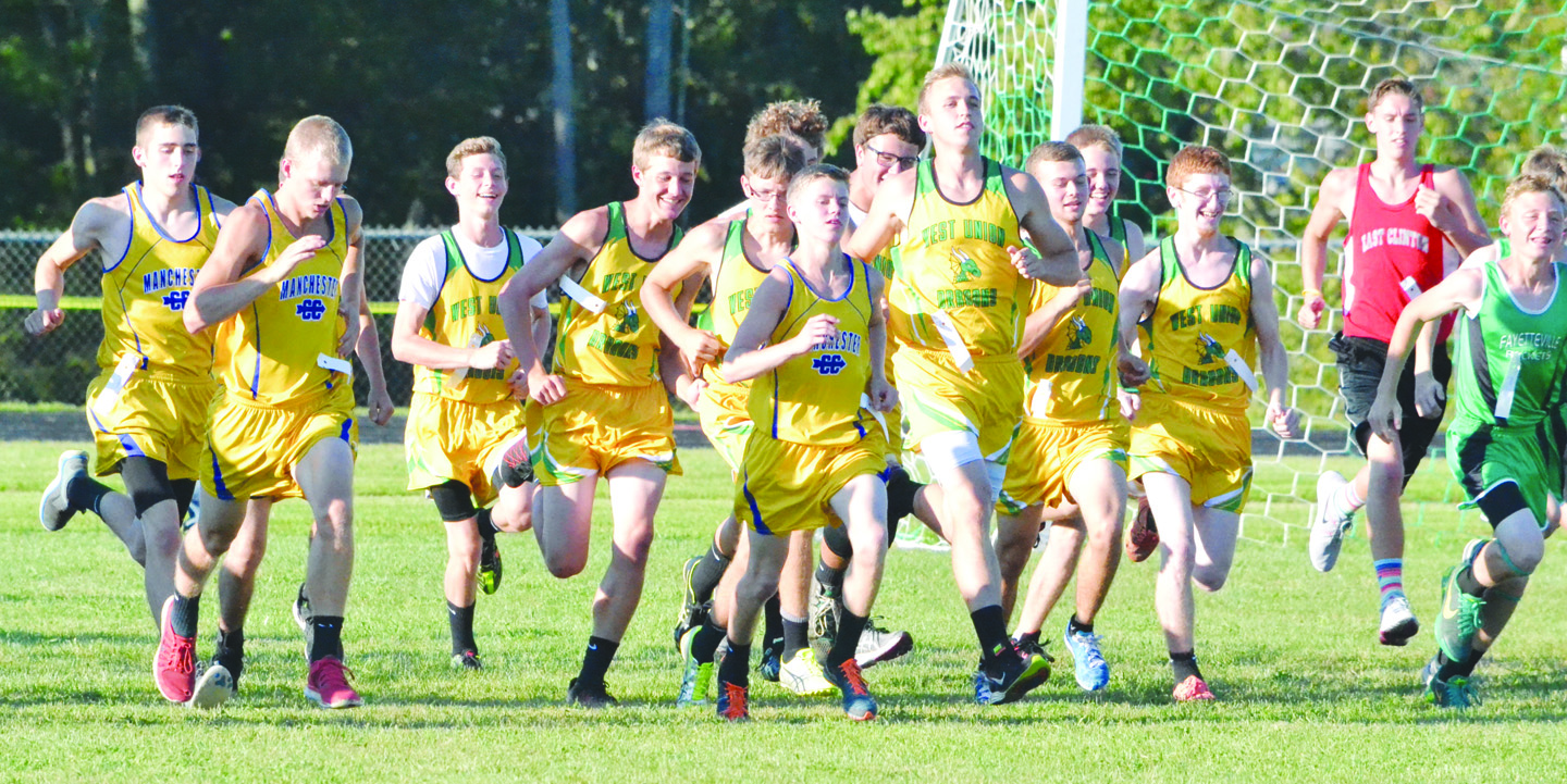 And they're off!  Part of the group of 66 runners in the high school varsity boys race at last week's Dragon Run take off  at the start line to begin their trip around the 5000 meter course.