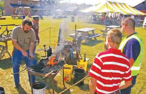 An old-style blacksmith demonstration is just one of many that you can view in action at the Adams County Heritage Days.