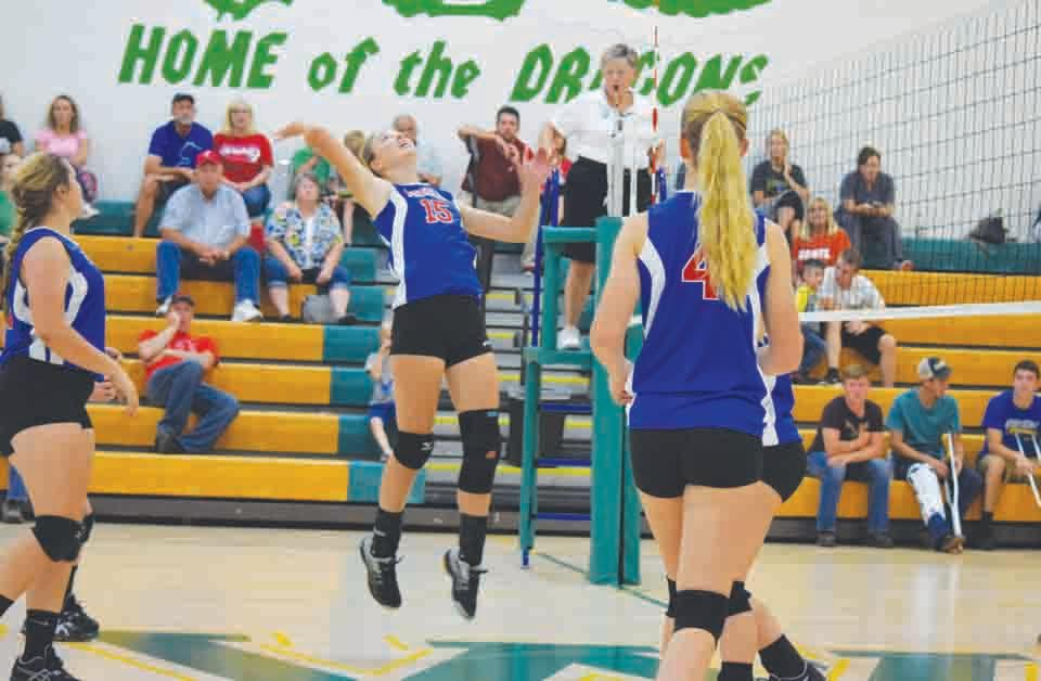 Peebles' Jessica Johnson, center, goes high for a kill attempt during action from the Lady Indians' three-set win at West Union last Thursday night.