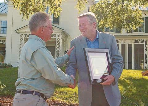 Tom Cross, left, accepts the ODNR Cardinal Award from ODNR Director James Zehringer.