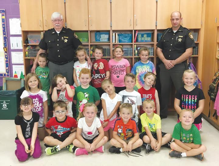 Adams County Sheriff Kimmy Rogers has definitely made an impression on the youth of Adams County.  When North Adams Elementary first grade teacher Kimberly Horsley asked her class what they wanted as an incentive for good behavior, they asked for a visit from the Sheriff and he gladly obliged.  Here, Sheriff Rogers and Deputy Micah Poe are seen during their visit to the class, many of whom have been part of the Sheriff's Junior Deputy Boot Camps.
