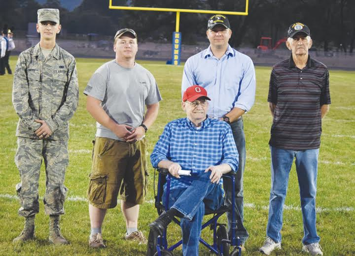 During pregame ceramonies before their Sept. 23 game with Jefferson Township, Manchester High School took time to honor these veterans in attendance and make them part of the coin flip at midfield.  Pictured, from left, J.D. Stamper (Air Force), Tyler Grooms (U.S. Army), Dallas Breeze (U.S. Navy), Paul Worley (U.S. Army), and James Breeze (Air Force)  Photo by Mark Carpenter