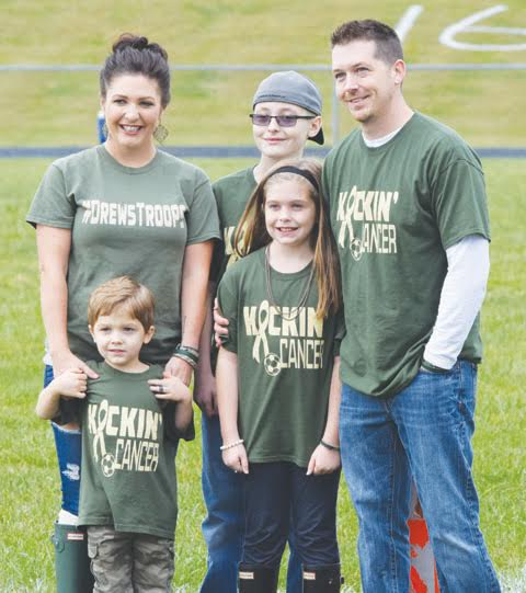 "The family of 11-year old Drew Reid, center with hat, was in attendance at Saturday's ""Kickin Cancer"" soccer games at North Adams High School."