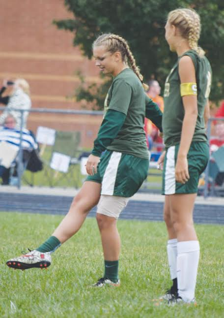 North Adams senior Jordyn Kell, left, out for the season with an injury, opened last Saturday's game with a ceremonial kick off.