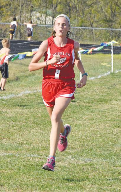 Peebles seventh grader Katy Seas closes in on the finish line on her way to winning the junior high girls race at last week's West Union Invitational.