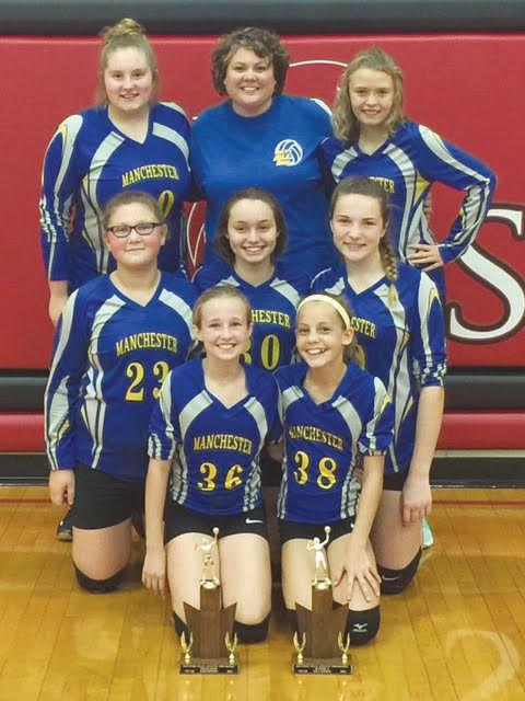 The seventh grade Manchester Lady Hounds were crowned as champions of the SHAC Tournament last weekend, knocking off North Adams 22-25, 25-9, 25-10.  They are pictured here with their hardware from the regular season and tournament,  Front row, from left, Kayden Francis and Mckenzie Morrison; Middle row, from left, Grace Hackney, Jada Francis, and Makenzie Fischer; Back row, from left, Zoe Arnold, Head Coach Crystal Roberts, and Santana Stanfield.