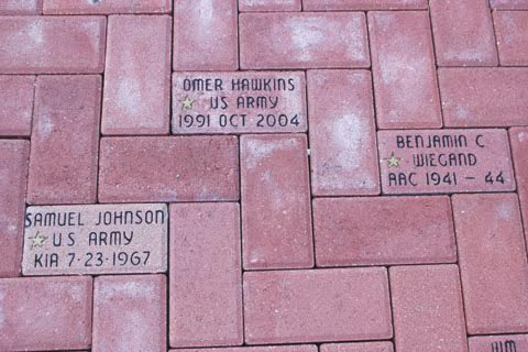 The brick memorials in front of the North Adams Library with the gold stars signify a veteran who was killed in battle.