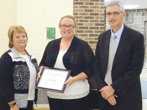 Peebles Elementary teacher Polly Spiller was recently honored by the ACOVSD Board of Education for her heroic actions in saving a student from choking.  Spiller, center, is pictured here with board member Judy Campbell and Superintendent Richard Seas.