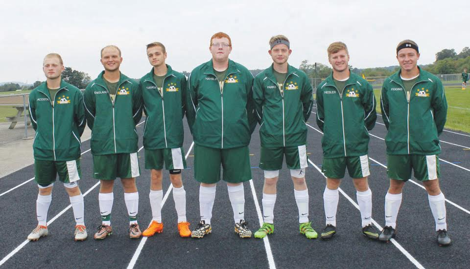 With their 1-0 loss to Bishop Rosecrans in the district tournament, the high school soccer careers came to a close for these seven North Adams seniors.  From left, Zeke Acosta, Patrick England, Kain Turner, Randall Hayslip, Austin Parks, Lee Hesler, and Ben Figgins.