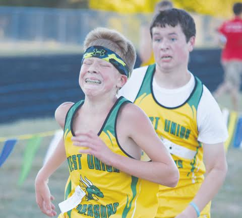 "With the weather a little cooler and a little more conducive to outdoor activity, cross-country runners from the four Adams County schools congregated at West Union High School for the annual Adams County Meet, capably hosted by the Dragons. It turned out to be a successful day for the ""Dog Pack"" runners from Manchester as they took two of the four individual titles and three of the four team titles, taking a lot of hardware back down to the river school. The day actually began with a rather unique race, a mile run for elementary students in grades four through six, though there were some younger runners mixed in.The top five runners in that race were Cody Hesler, Nick Seas, Wesley Ellis, Landon Fulton, and Beau Hesler. Eighteen junior high girls made up the next race, with all of them shooting for top seven finished that earned All-County honors and of course, high enough finishes for their school to take home the team trophy. Seven runners earn All-County honors in direct correlation with OHSAA rules that allow just seven runners from a team to compete in postseason competition. Setting the pace in the junior high girls race was Manchester's McKenzie Morrison,, who won the race with a time of 13:16, with Peebles' Katy Seas second at 13:33. Third place went to Manchester's Abby Freeman at 13:45, and the final four All-County spots went to West Union's Katie Fulton (13:49), West Union's Adelyn Shupert (13:59), West Union's Kendra Grooms (14:08), and North Adams' Ainsley Grooms (15:00). Next up were the junior high boys with 27 runners and taking the first place slot was North Adams' Trenton McCann with his time of 12:48. Finishing in second was Manchester's Denton White with a time of 12:57, followed in third place by West Union's Chris Schulz at 13:13. Rounding out the junior high boys All-County runners were Damon Baker from North Adams (13:14), Jai-Michael Knox from West Union (13:19), Ryland Wikoff from Manchester (13:35), and Braxton Blanton from West Union 913:35.96). In the ensuing high school girls race, Peebles had three of the top five finishers, but with only four total runners, could not qualify for the team title which they most surely could have won. As it was, the race was paced by the incredible stride and effort of Peebles' Jenny Seas, who easily took the first place medal with her time of 19:22, over two minutes ahead of second place finisher Anna Shupert of West Union, who came into the chute at 21:58. Third place in the high school girls race went to Peebles' Alisan Behr at 22:55, fourth place to Manchester's Shyanne Tucker at 23:10, fifth place to Peebles' Abby Faulkner at 23:50, sixth place to Manchester's Billie Kinhalt at 24:25, and rounding out the All-County team in seventh place was Manchester's Kelsey Friend with a time of 25:01. The high school boys race could be described as the polar opposite of the high school girls race. While the high school girls race wasn't even close, the boys race went right down to the final 50 yards in a battle between Peebles' Matt Seas and Manchester's Ethan Pennywitt. The two were neck and neck for the entire course with Seas holding a slight lead most of the way, but in the final stretch, Pennywitt turned it up a gear and passed Seas, winning the sprint to the finish line and the race with a time of 17:30, barely edging out Seas' 17:31. Third place in the high school boys race went to Manchester's Jamie Combs (18:28), fourth to West Union's Janson Kramer (18:36), fifth to Peebles' Sammy Smith (18:47), sixth to West Union's Adam Fulton (18:52), and the final All-County berth to Peebles' Seth Chamblin (19:13). Local fans can get another glimpse at most of these local runners next Tuesday, Oct. 4 as the West Union Invitational comes to town."