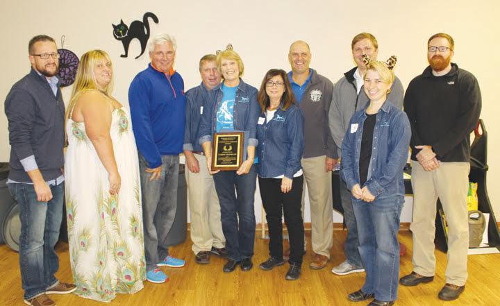 At the annual Humane Society Howl-O-Ween Dinner and Auction, Karen Franklin was honored with the Community Service Award.  Pictured here at that presentation are, from left, Ryan Chadwick, Deanna Turner, Ty Pell, Brian Mason, Karen Franklin, Barbara Jones, Brian Baldridge, Paul Worley, Jessica Huxmann, and Todd Mitchell.
