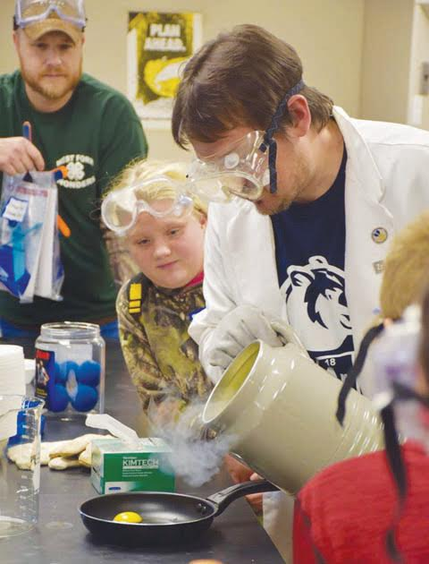 4-H advisor Taylor Goon and 4-H Tech Wizard Teagan Lloyd, both of Winchester, look on during a demonstration in the Chemistry Department during Saturday's Maker Festival at Shawnee State University.