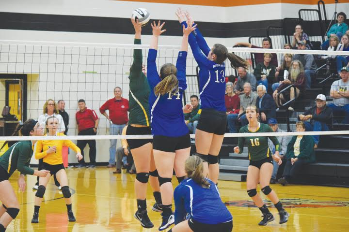 With the size of both teams, there was a lot of action at the net during last week's district semi-final volleyball match in Waverly.  Here, North Adams' Avery Harper attempts to find an open spot over the outstretched arms of a pair of Southeastern blockers.