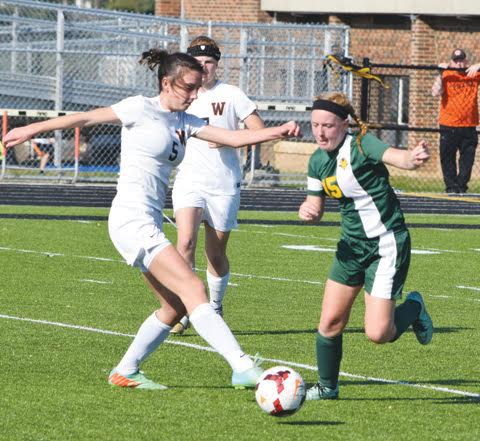 North Adams' Haley Robinson, right, battles a Wheelersburg opponent for possession during action from last Saturday's district championship game in Waverly.