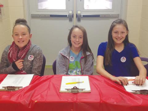 Pictured here are sixth grade students supervising the election process as poll workers.