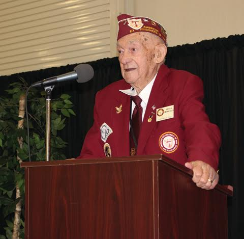 One of the speakers at last week's Veterans Day program at GE was Adams County's own Grover Swearingen, whose exploits were documented last year in The People's Defender.