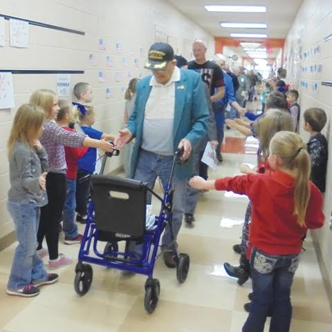 Peebles Elementary students line the hallways to greet the veterans as part of the school's annual Veterans Day parade.