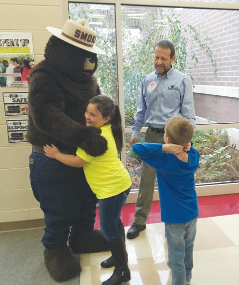 "Students at Peebles Elementary recently got the opportunity to meet their favorite fire-preventing bear as part of the ""Trees To Textbooks"" program."