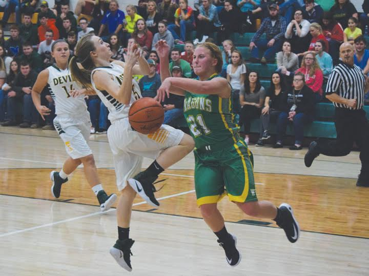 North Adams' Maddie Toole, left, is fouled on this drive to the basket by West Union's McKenzie Kirker (21) during action from the final half of last Friday night's Southern Hills Athletic Conference girls preview, hosted by North Adams High School.