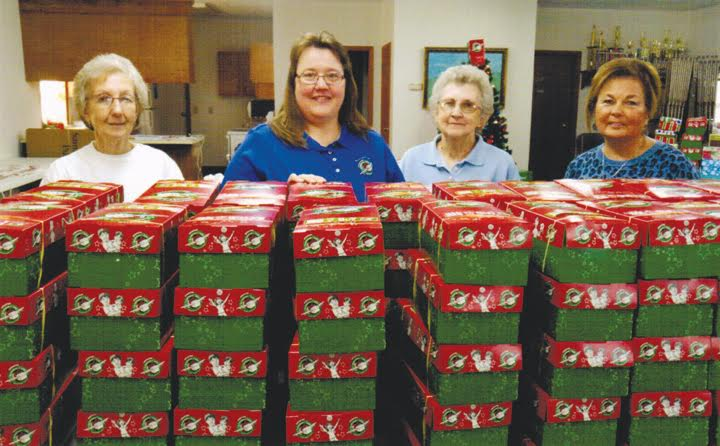 From left, Linda Ralston, Angela Horvath, Judy Young, and Pat Mustard with the shoe boxes just delivered to the Collection Center and ready to be packaged and shipped.