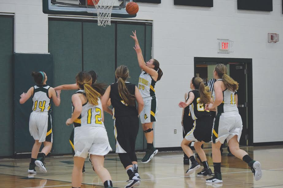 North Adams freshman Alaina Eiterman goes up for two of her game-high 16 points as the Lady Devils' JVsquad defeated Paint Valley 37-18 in their season opener on Nov. 29.
