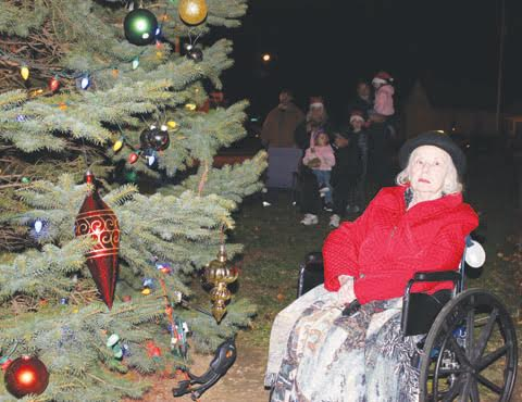 Sharon Malcom, right, and her family handled the duties on Saturday night of lighting the Christmas tree at the Hometown Christmas festivities in Peebles.