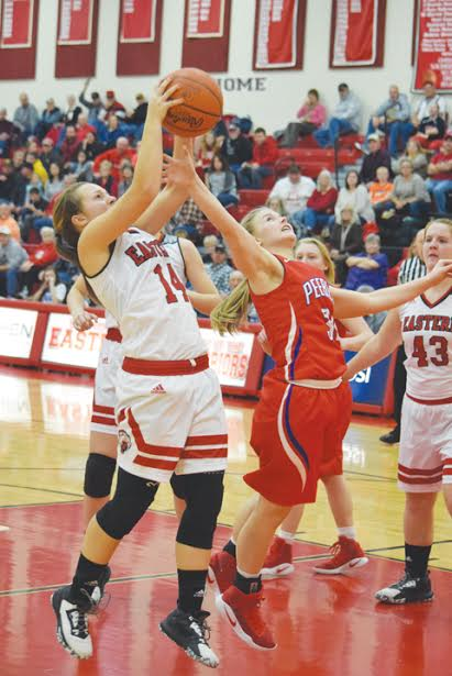 Peebles' Baylee Justice, right, battles for a rebound with Eastern's Morgan Reynolds in action from Monday night's SHAC battle, won by the Lady Warriors 50-39.