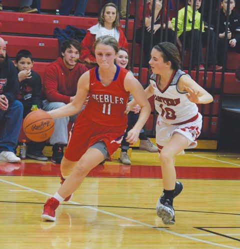 Peebles' Matti Nichols looks for room around the corner against the defense of Eastern's Camryn Pickerill during the second half of Tuesday night's SHAC contest.