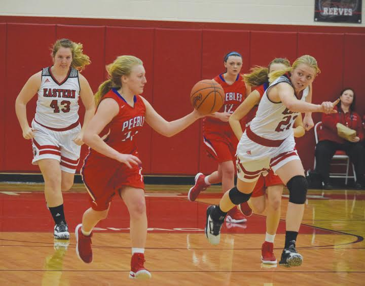 Peebles' Jerilin Toller pushes the ball ahead on the break during second half action from Monday night's varsity girls contest.