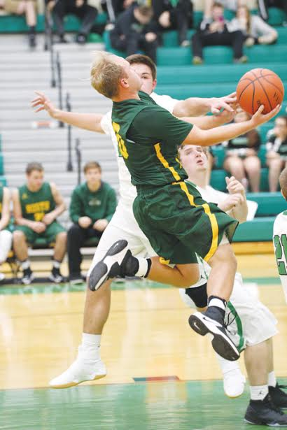 North Adams' Patrick England goes up for a contested shot during Tuesday's SHAC contest in Fayetteville.  England scored 16 points as the Devils came home with a 71-54 victory.