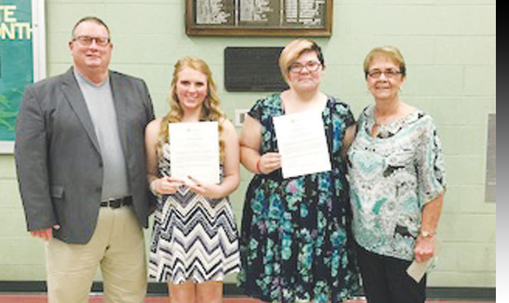 From left, Dennis Sizemore, Scholarship winners Madison Welch and Chelsey Yates, and Janet Campbell.