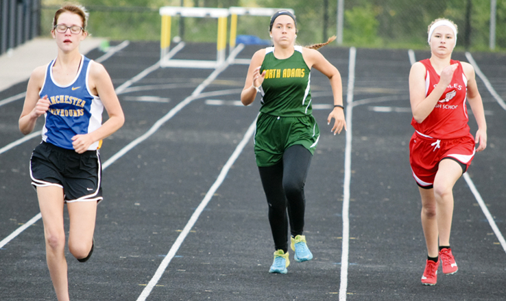 From left, Manchester's Kelsey Friend, North Adams' Brooklyn Wylie, and Peebles' Cherokee Runyon compete in the 400 Meter Dash at last Friday night's SHAC track meet at Lynchburg.