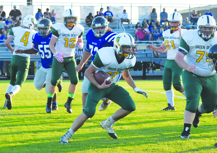North Adams running back Dustin Dotson looks for space against the Mason County defense in the first half of last Friday night's varsity football game played at Mason County High School.