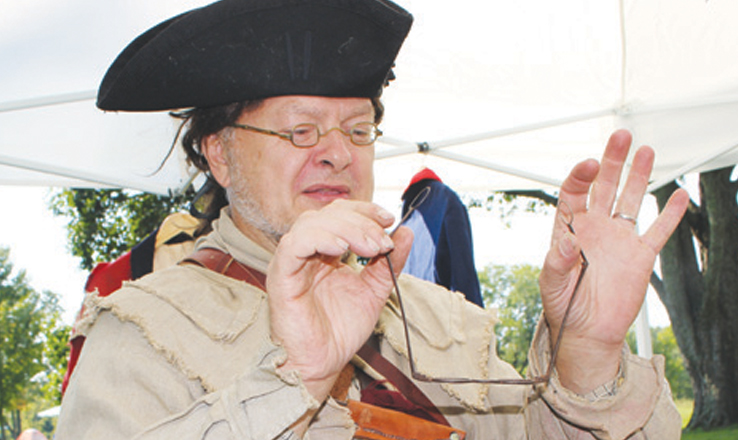 This 18th century re-enactor told stories of life on the frontier as part of the annual Archaeology Day at Serpent Mound.