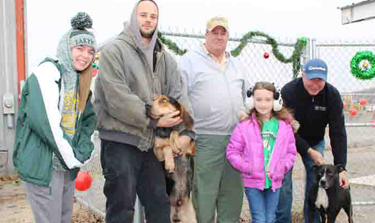 Deputy Dog Warden Donnie Swayne, third from left, and Adams County Commissioner Ty Pell, far right, are among those pictured here at last weekend's Open House at the Adams County Dog Pound.