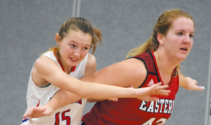 Peebles' Christian Reed, left, battles with Eastern' Mikayla Farris for position in the post in action from Monday night's varsity girls game.