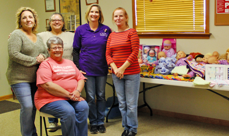 Pictured with some of the dolls that were delivered as part of the Senior Citizens Center Drive are: Seated, Chris Brooks; Standing, from left, Jackie Wilson, Teresa Carr, Mary Stout, and Joyce Gaffin.