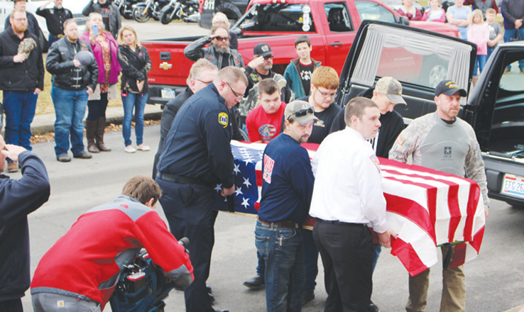 The flag-draped coffin of U.S. Army veteran Justin Richmond is unloaded on Wednesday after a procession from the Greater Cincinnati Airport to Adams County.
