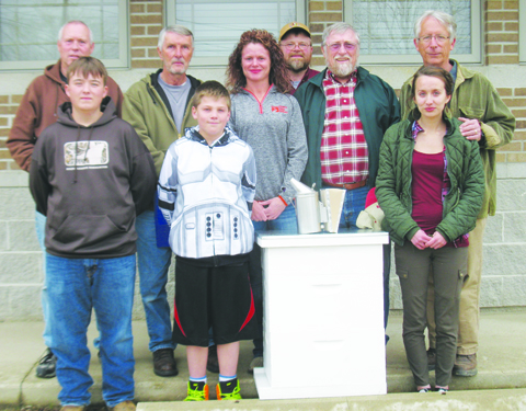 Front row, from left, Scholarship winners Joshua Burns, Chase Thompson, and LaRanda Piatt; Back row, from left, Terry Robinson, mentor, Buck Williams, mentor, Emilee Arthur, President Adams County Farm Bureau, Bill Wickerham, Adams SWCD District Mgr./Adams Co Apiary Inspector, Kenny Moles, Adams County Beekeepers Association President, and Andrew Frowine, mentor.