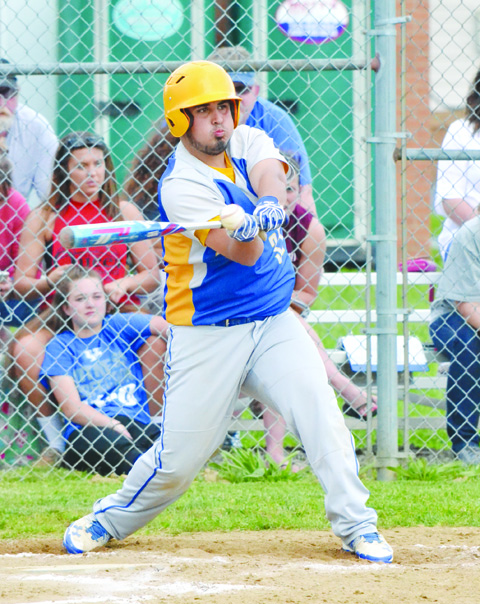 This swing by Manchester's Mason Applegate produced the only run in the Hounds'1-0 win over Green in the Division IV sectional championship game.  Photo by Mark Carpenter.