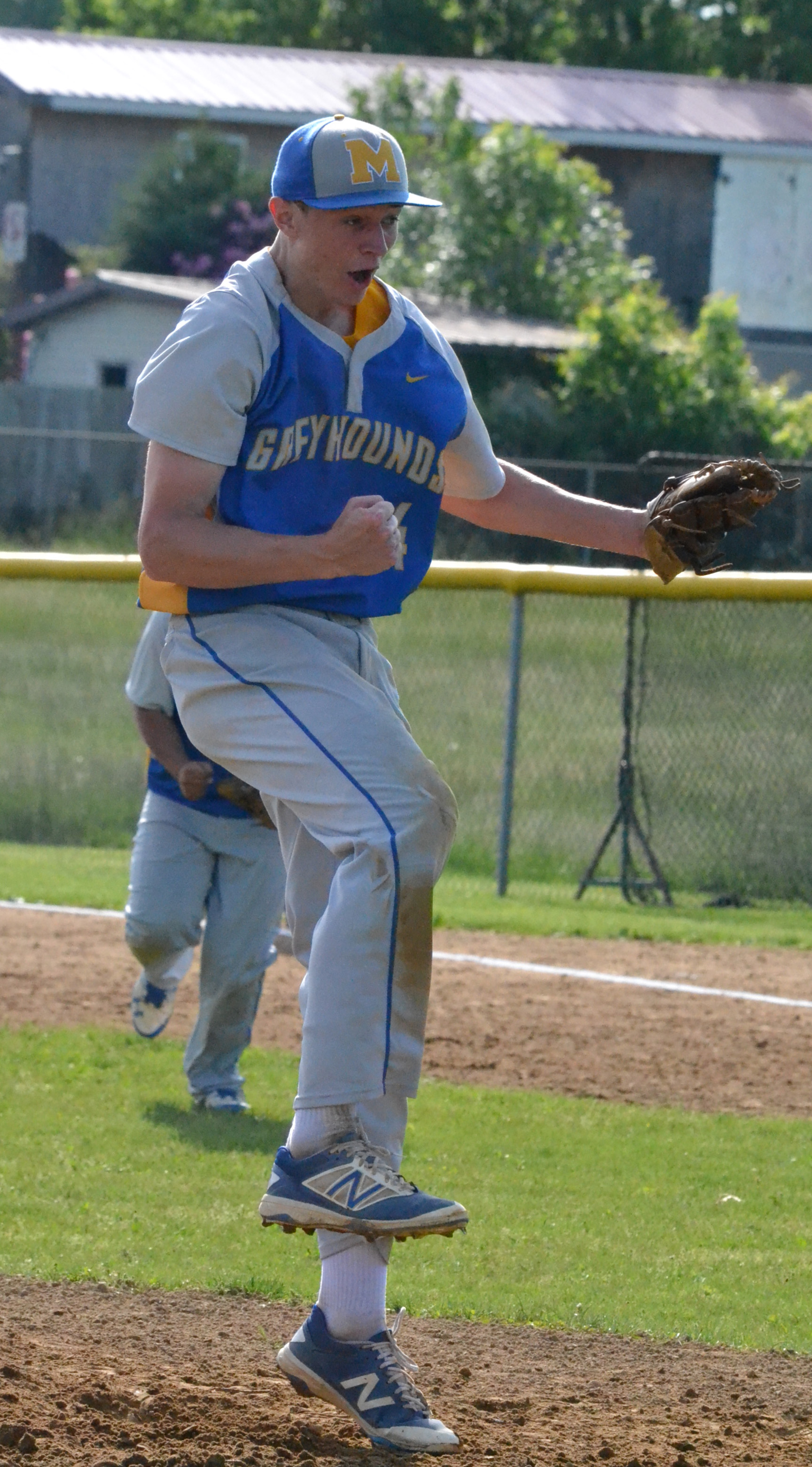 Manchester's Sean Frost celebrates after recording the final out in the Greyhounds' 1-0 sectional title win over Green.  Photo by Mark Carpenter.