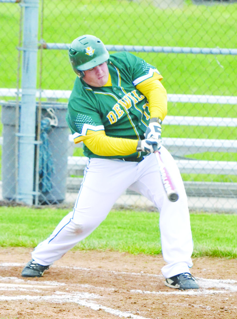 North Adams senior Avery Lucas attempts to check his swing during action from Tuesday's varsity baseball game, won by the Devils over Manchester 7-2.  Photo by Mark Carpenter