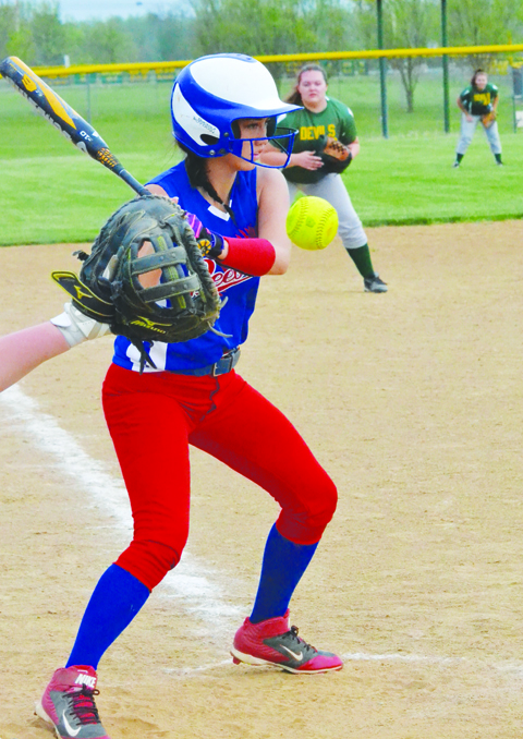 Peebles' Sierra Stone watches this offering sail high during action from last week's Lady Indians 9-2 win at North Adams.  Photo by Mark Carpenter