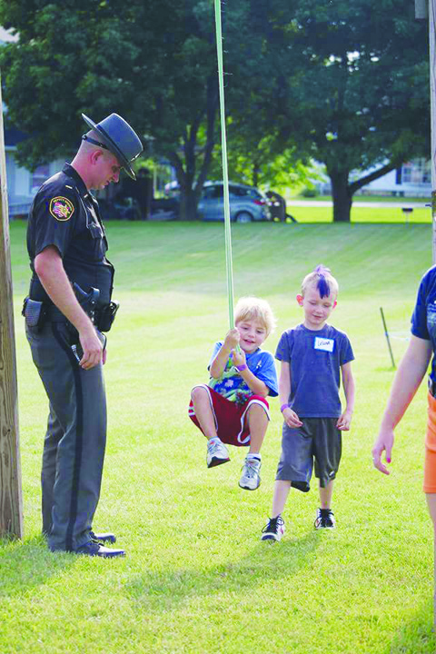Deputy Micah Poe, left, oversees some of the physical activity involved in last week's Junior Deputy Boot Camp in Peebles.